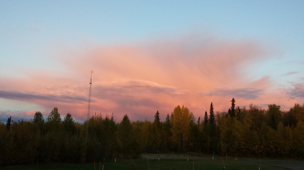 pink clouds over the back of our property